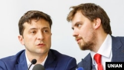 Ukrainian President Volodymyr Zelenskiy (left) and the deputy chairman of the Office of the President, Oleksiy Honcharuk, who is believed to be the top pick for prime minister.