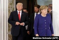 """Дональд Трамп и Ангела Меркель во время встречи накануне начала саммита """"Большой двадцатки"""""""