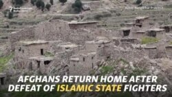 Islamic State Prisoners Shown To Media As Afghans Return To Ruins