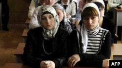 Headscarf-wearing female students attend classes at the Grozny State Oil Institute in Chechnya.