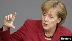 """German Chancellor Angela Merkel also said no country in trouble should be """"left on its own"""" in a crisis."""