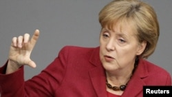 "German Chancellor Angela Merkel also said no country in trouble should be ""left on its own"" in a crisis."