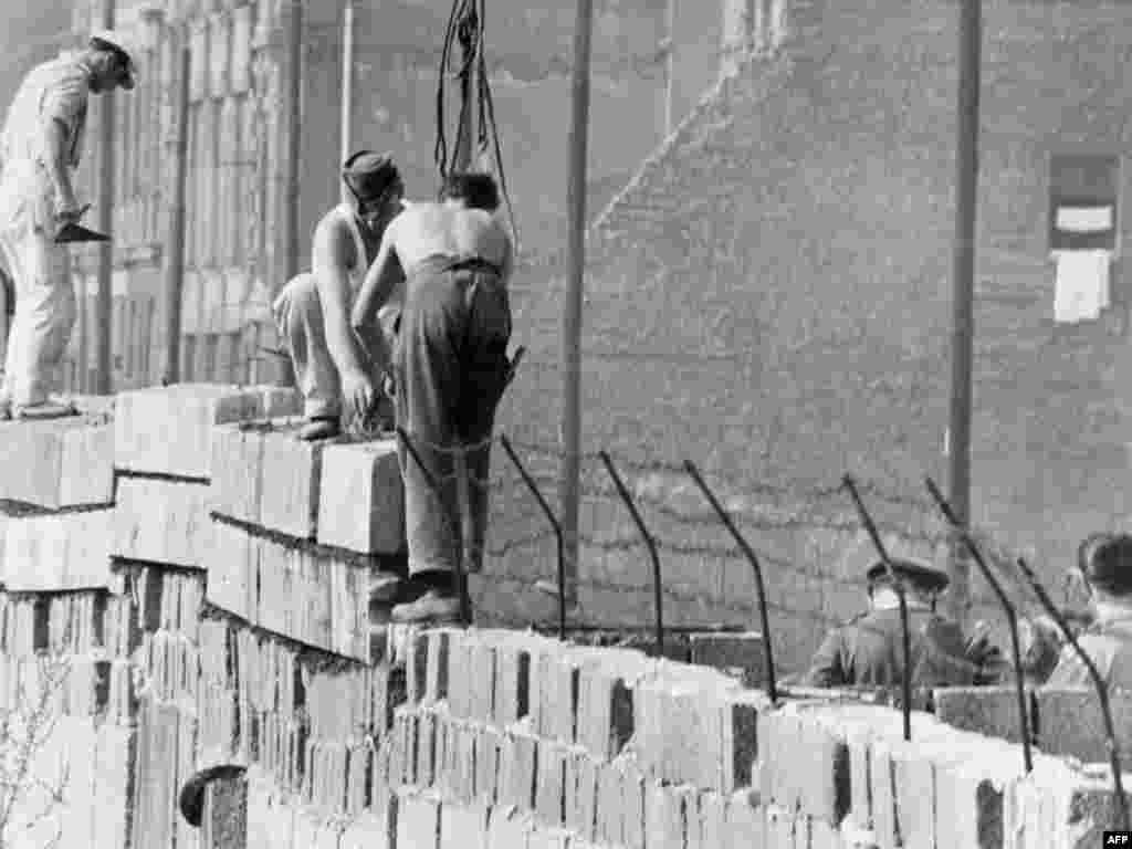 Builders work on the Berlin Wall on October 1, 1961, built under Khrushchev's directive.