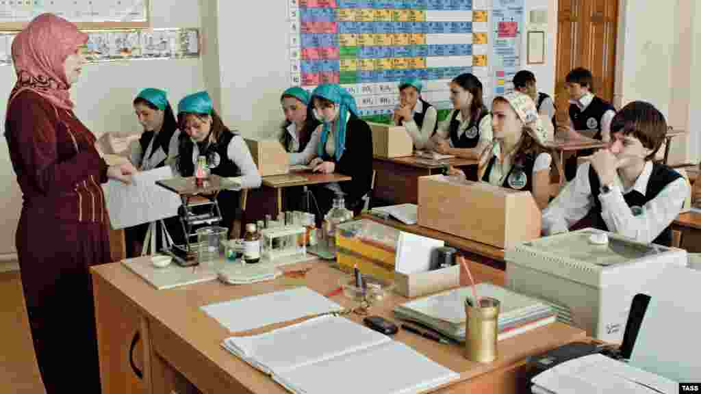 Children study chemistry at a school named after former Chechen leader Akhmad Kadyrov in Grozny.