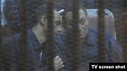 Египет -- мурдагы президент Хосни Мубарак уулу Гамал менен, Каир, 2013