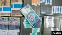 Tenge banknotes are seen at a bank branch in Almaty (file photo)