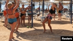 Russian tourists take belly-dancing lessons at a Red Sea resort last month. Meanwhile, a senior tourism official has raised hackles at home by suggesting beach holidays may be anathema to the Russian soul.