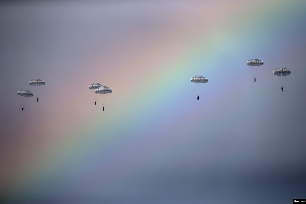 Russian paratroopers jump from an IL-76 transport plane during a joint Serbian-Russian military training exercise in the town of Kovin, near Belgrade. (Reuters/Marko Djurica)