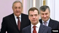 "Russian President Dmitry Medvedev (with the leaders of breakaway Abkhazia and South Ossetia) called the Georgia exercises a ""blatant provocation."""