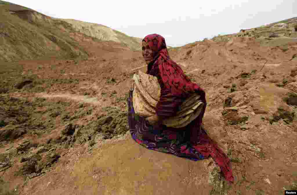 An Afghan woman cries after she lost her family in a landslide in the Argo district in Badakhshan Province. (Reuters/Mohammad Ismail)