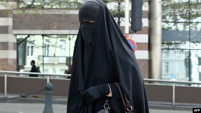 A Muslim woman dressed in niqab walks through the streets of Brussels.