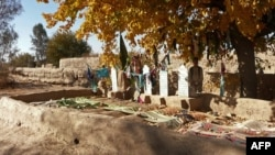 A man stands alongside the graves of some of the 16 Afghan villagers killed by U.S. soldier Robert Bales during his shooting spree in Kandahar Province in March 2012.