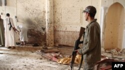 A suicide bomb attack killed at least five people inside a mosque in Dhuluiyah on April 22.