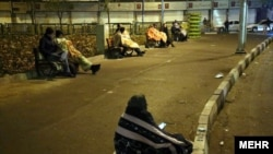 People spending the night in the streets.
