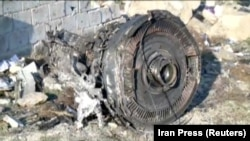 One of the engines of the Ukrainian flight that crashed in Iran lies among the wreckage.