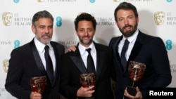 "U.K. -- Ben Affleck (R), George Clooney (L) and Grant Heslvov celebrate after winning the Award for Best Film for the movie ""Argo"" at the British Academy of Film and Arts (BAFTA) awards ceremony at the Royal Opera House in London, 10Feb2013"