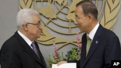 Palestinian leader Mahmud Abbas (left) delivers a letter requesting recognition of Palestine as a state to Secretary-General Ban Ki-moon during the 66th session of the General Assembly at United Nations headquarters in New York on September 23.