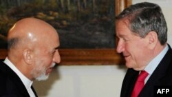 Do Afghan President Hamid Karzai (left) and U.S. special envoy Richard Holbrooke see eye-to-eye on which insurgents can be talked to?
