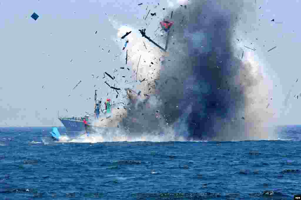 The Indonesian Navy blows up a foreign fishing vessel that it had seized when it was caught fishing illegally in the Indonesian Sea. (epa)