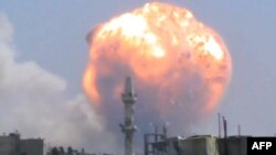 An image grab taken from a video uploaded on YouTube appears to show the explosion at the Homs ammo depot.