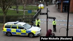 Britain - Police officers continue to guard the scene where a forensic tent in the centre of Salisbury