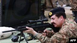 Pakistani Army chief, General Raheel Sharif, trying a rifle on his visit to the Pakistan Ordnance Factories, Wah on April 6.