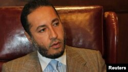 Saadi Qaddafi during a news conference at his office in Tripoli in 2010