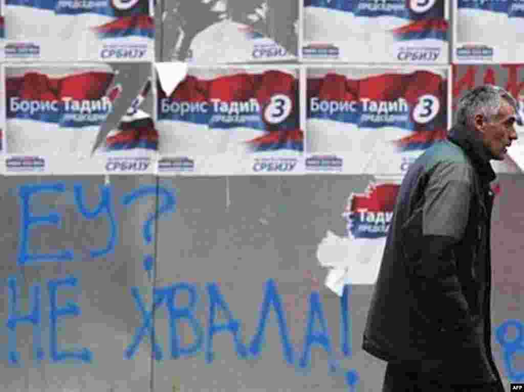 "Preelection graffiti: ""EU? No Thanks!"" - Serbia on January 20 held the first round of a presidential election that comes as the country's breakaway province of Kosovo is preparing to declare independence. With many observers considering the election to be a referendum on Serbia's EU ambitions, RFE/RL asked Belgrade residents whether they see their future with Europe or with Russia, and why the Kosovo issue is such an emotional one for Serbs."