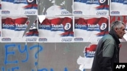 "Campaign posters of the President Boris Tadic's Democratic Party are posted over graffiti reading ""EU? No thanks!"" in Belgrade."