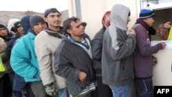 Afghan migrants wait for food aid in Calais, France. According to a recent report by the United Nations, one in four refugees in the world is from Afghanistan. (file photo)