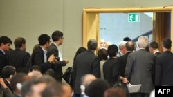EU delegates leave the assembly room during Ahmadinejad's speech.