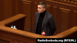 Mykhaylo Tkach speaks before Ukraine's parliament in November 2019.