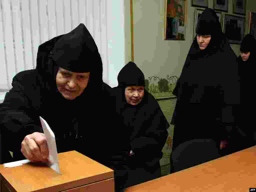 An Orthodox nun casts her ballot in the town of Grodno.