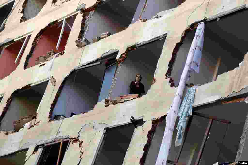 A woman looks out from a damaged police building after a blast in the Kurdish-dominated southeastern city of Diyarbakir, Turkey. At least eight people were killed in a blast believed to have been a car bomb, blamed by authorities on the Kurdistan Workers Party. (Reuters/Sertac Kayar)