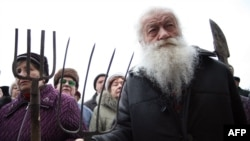 Elderly protesters rally with pitchforks and spades outside the offices of the regional governor in Donetsk.