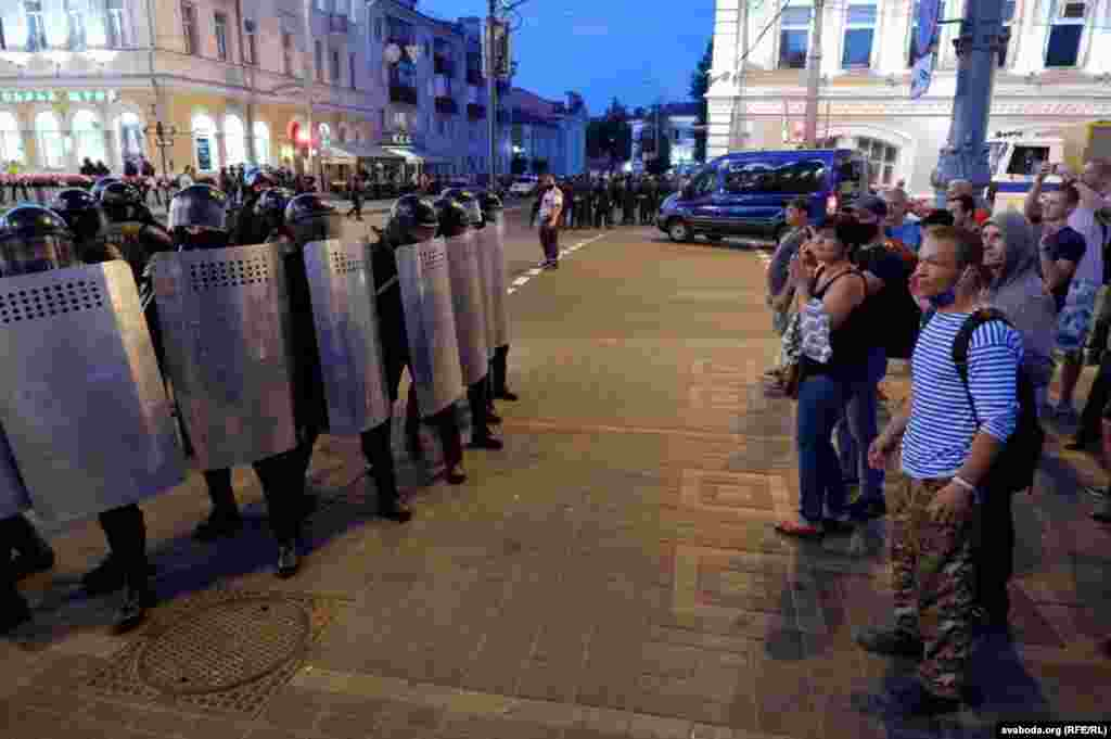Anti-government protesters face off with security forces in Homel.