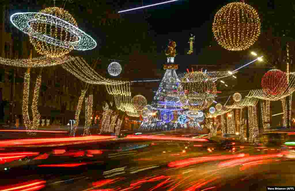 Christmas decorations adorn the streets of the Georgian capital, Tbilisi, late on December 24. (AFP/Vano Shlamov)