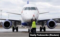 A Belavia passenger jet lands at Minsk airport in 2019.