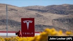 The U.S. Justice Department says Yegor Kryuchkov offered a Tesla employee $1 million to install malicious software to get access to the firm's networks as part of an extortion scheme.