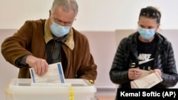 A man casts his ballot at a polling station in Sarajevo on November 15.
