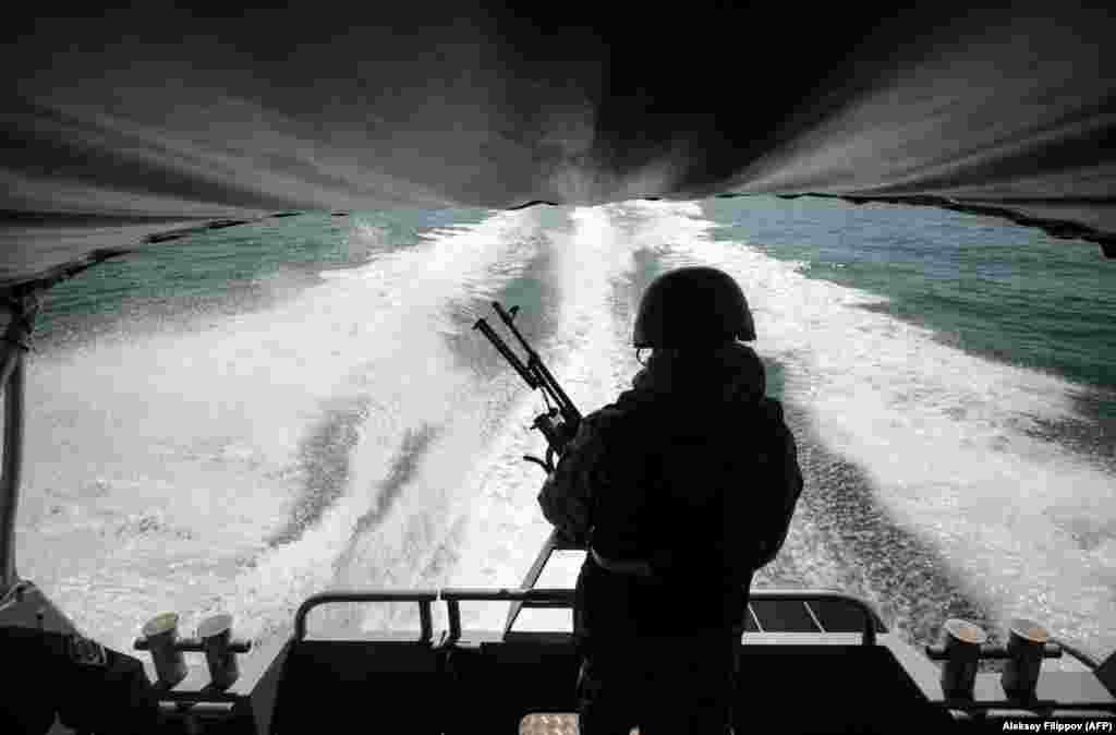 Ukrainian border guards patrol the Sea of Azov off the city of Mariupol on April 30. (AFP/Aleksey Filippov)