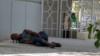 Turkmenistan. Drunk man sleeping on the ground. Ashgabat. July 2021