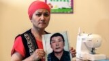 KAZAKHSTAN-CHINA-RIGHTS-XINJIANG-COURT Bikamal Kaken poses with a portrait of her disappeared husband Adilgazy Muqai in a rental apartment in the provincial town of Uzynagash, around 60 kilometres from Kazakhstan's largest city Almaty, on August 27, 2020.