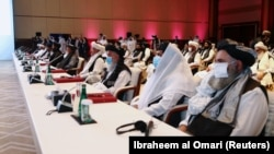 Delegates attend talks that kicked off between the Afghan government and Taliban insurgents in Doha on September 12.