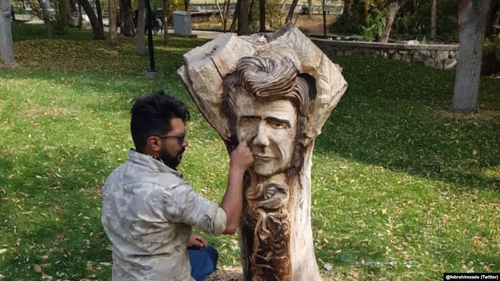 Iran -- Shajarian memorial carved by