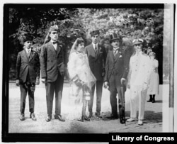 """""""Princess Fatima"""" with her three adult sons and another man (in top hat). In the white uniform is Stanley Jacob Weinberg, in character as U.S. official Rodney S. Wyman."""