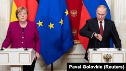 Russian President Vladimir Putin and German Chancellor Angela Merkel last met in Moscow on January 11, 2020.