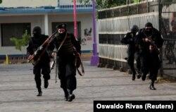 Нікарагуанскі АМАП змагаецца з пратэстоўцамі. Масая. 13 ліпеня 2018