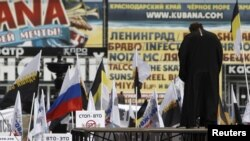 An Orthodox priest addresses the crowd during a rally by nationalist and religious political groups in Moscow in April 2012.