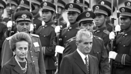 China -- Romanian President Nicolae Ceausescu (R) and his wife Elena in Beijing, October 14, 1988.